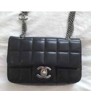 Chanel small black bag with chain strap detail